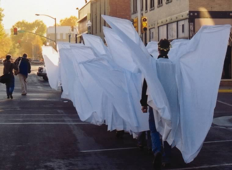 Beverly walking down Ivinson Ave. with angels to demonstration at Albany County Courthouse